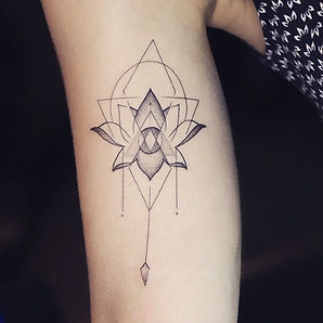Best geometric fine line Thai lotus tattoo at Baan Khagee Tattoo Chiang Mai, Thailand