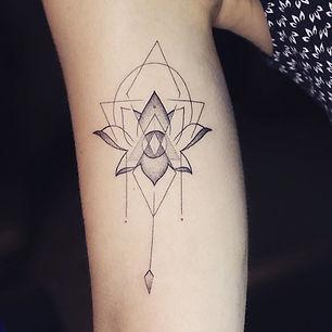 Best geometric fine line lotus tattoo at Baan Khagee Tattoo Chiang Mai