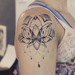 Best fine line lotus tattoo at Baan Khagee Tattoo Chiang Mai
