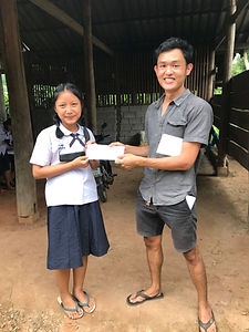 Giving scholarship to the kid in Mae Win by Baan Khagee Tattoo Chiang Mai, Thailand