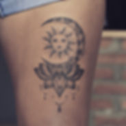 Line work moon tattoo with the sun and lotus flower at Baan Khagee Tattoo Chiang Mai