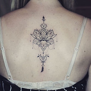 Best fine line ornamental lotus tattoo at Baan Khagee Tattoo Chiang Mai