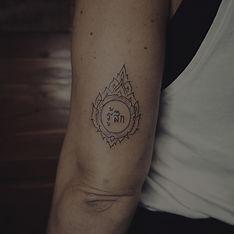 Minimal fine line Thai art tattoo by Baan Khagee Tattoo Chiang Mai, Thailand