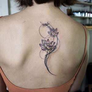 Best fine line lotus tattoo with water wisp and fine line geometry at Bann Khagee Tattoo Chiang Mai, Thailand
