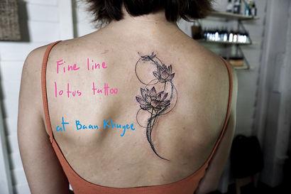 Best Fine line lotus tattoo by a tattooist at Baan Khagee Tattoo Chiang Mai, Thailand