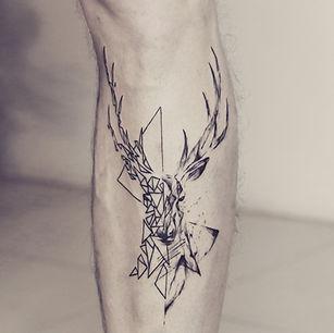 Best Half geometric half abstract stag tattoo at Baan Khagee Tattoo Chiang Mai, Thailand