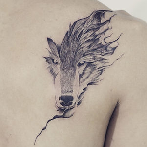Best Abstract blackwork wolf face tattoo at Bann Khagee Tattoo Chiang Mai, Thailand