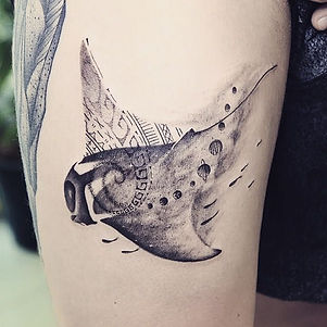 Best blackwork manta ray tattoo with polynesian art at Baan Khagee Tattoo Chiang Mai, Thailand