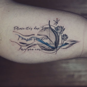 Best fine line arrow tattoo with lotus and abstract art at Baan Khagee Tattoo Chiang Mai