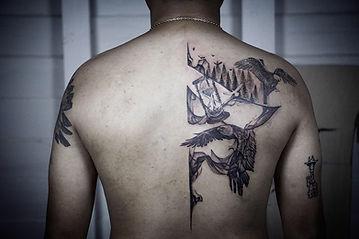 Best Blackwork eagle tattoo with abstract flow Baan Khagee Tattoo Chiang Mai, Thailand