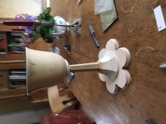 The cup and stem are turned from poplar wood on a lathe.