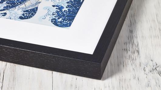 Black wooden frame near corner