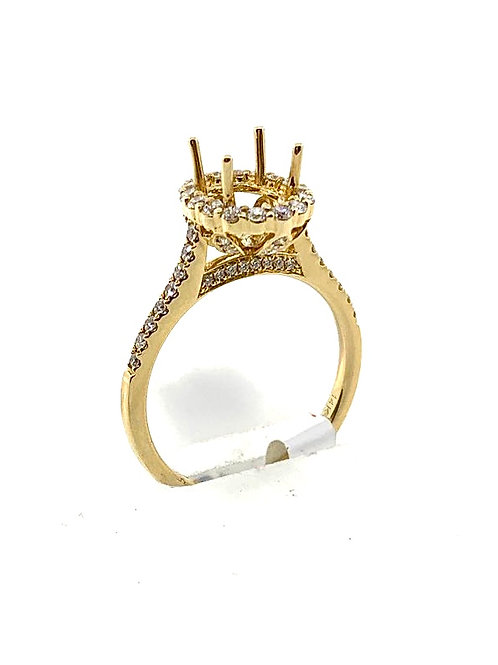 Oval halo engagement setting yellow gold