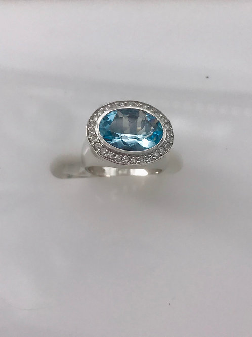 Oval Blue Topaz Diamond Ring