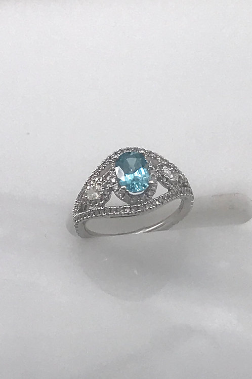 Oval Blue Zircon Ring with Two Semi Oval Pear Shapes