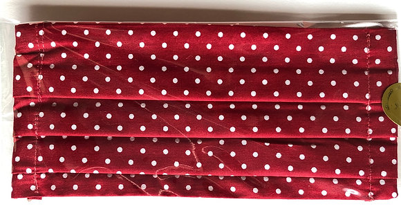 Red w/ white polka dots. Kid size