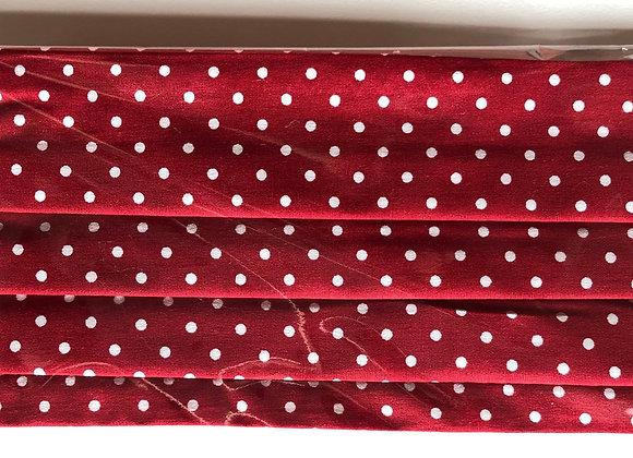Red w/ white polka dots. Kid size