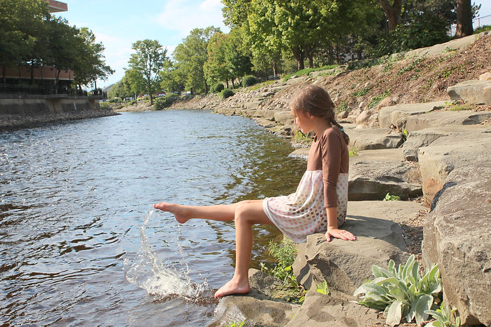 girl kicking water