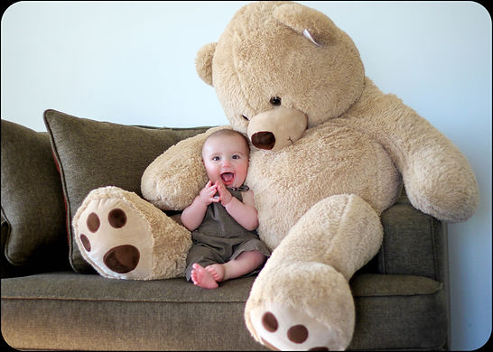 cute baby boy with teddy bear