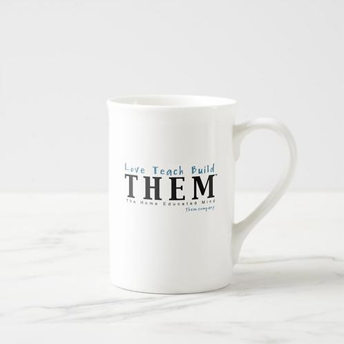 Love Teach Build THEM 10 oz. Coffee Mug