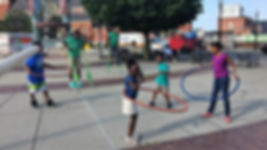 Kids with Hoops and Stilts in Dorchester