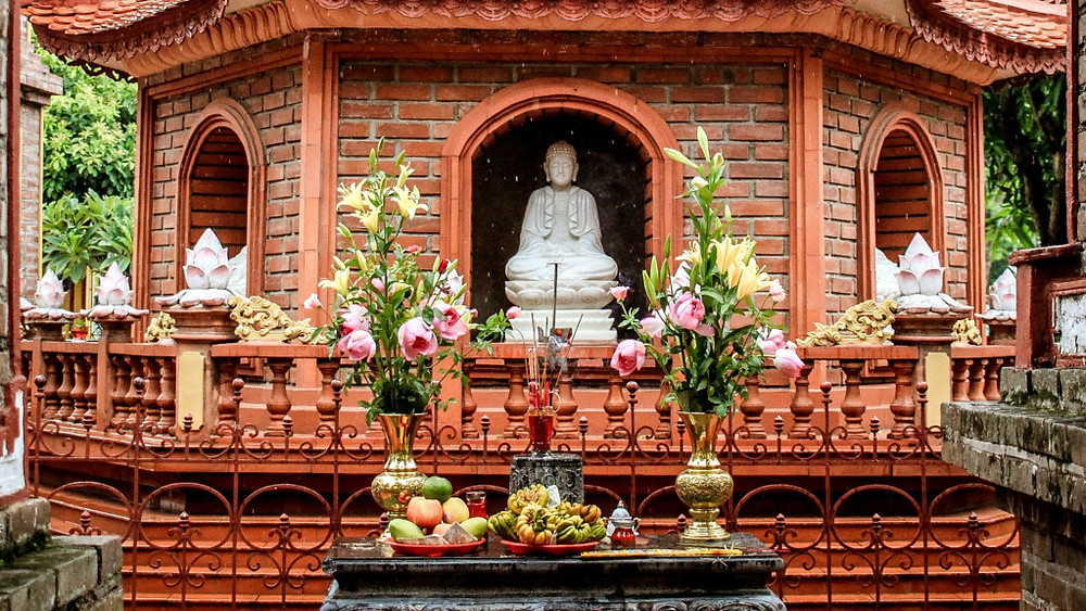Offering to Buddha in a temple in Southeast Asia