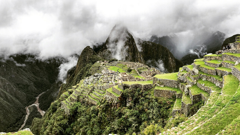 Cloud shrouds the ruins of Machu Picchu in a classic travel photo