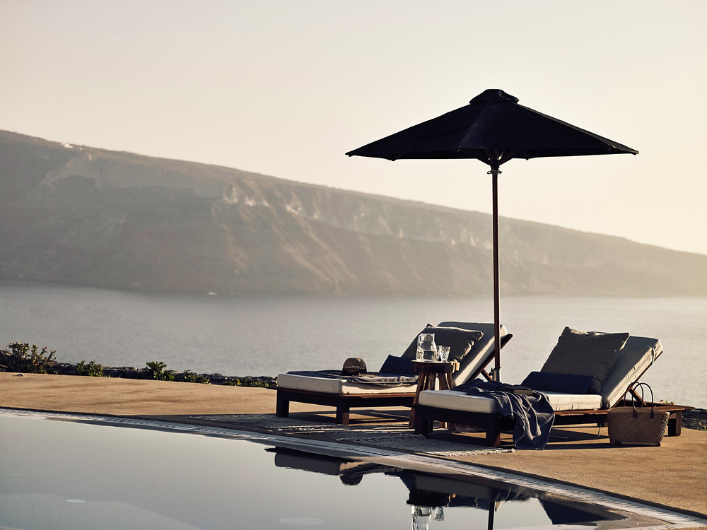 A couple celebrate their honeymoon in a luxurious suite in Santorini