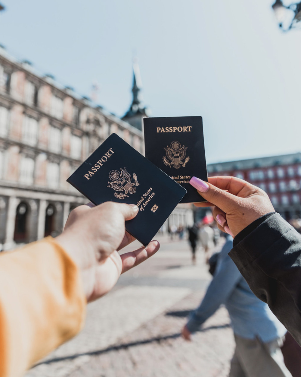 Friends showing their US passports in Madrid, Spain