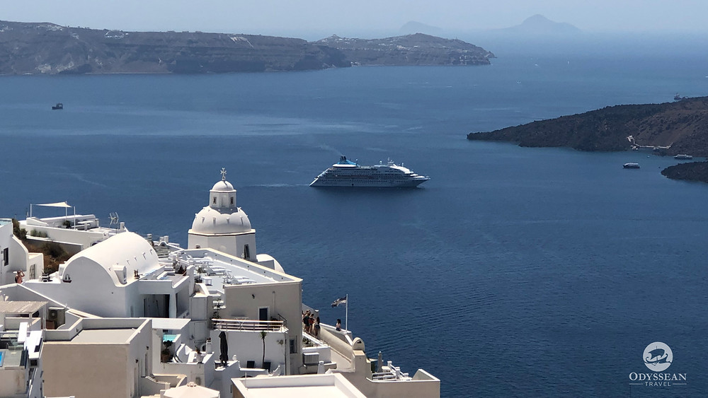 View over Santorini's Caldera from Thera onto a cruise ship at the volcano