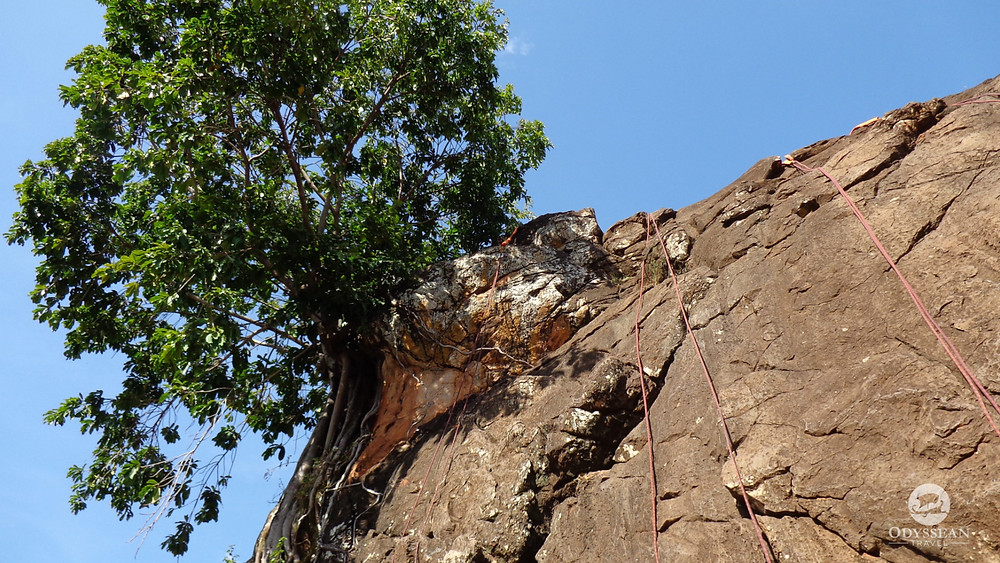 Rock climbing equipment set up for a riverside climb in Kenya