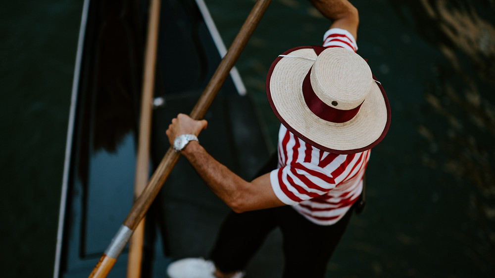 An overhead view of a gondolier on the canals of Venice, Italy