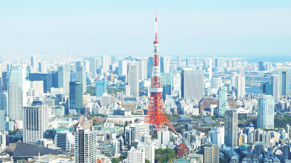 The orange Tokyo Tower sticks out among somewhat drab buildings of Tokyo's skyline