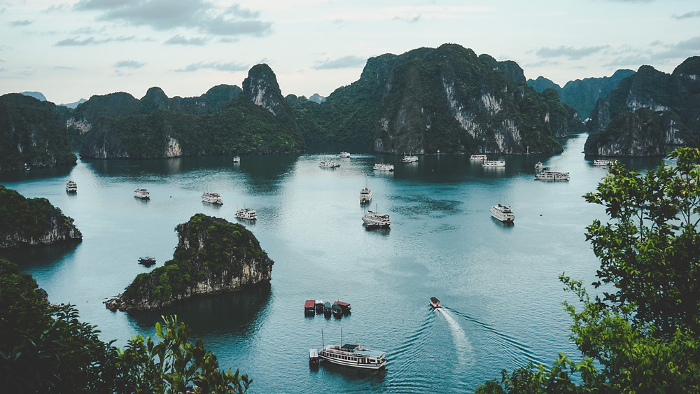 View over Ha Long Bay, Vietnam. Boats on blue water