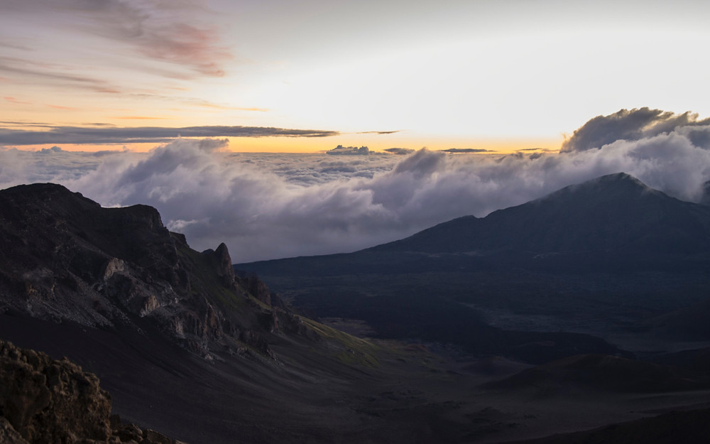 Sunrise over the clouds as seen from the top of Mount Haleakala in Hawaii
