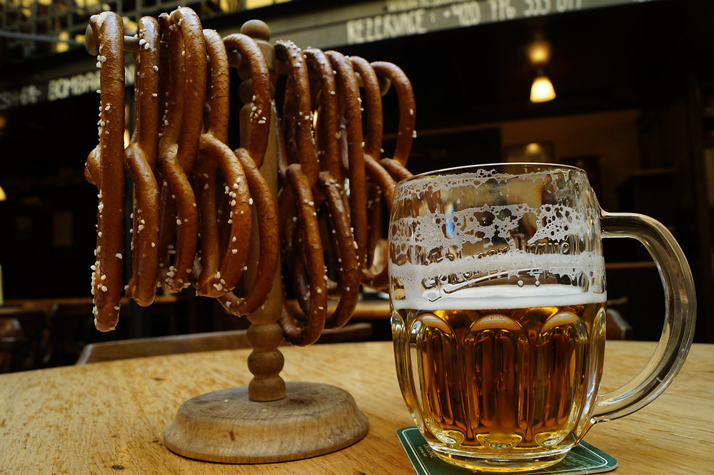 Half full glass of Czech beer and fresh pretzels at a terrace bar in the Czech Republic