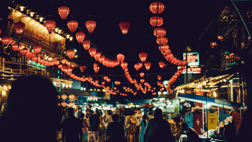 Night market with lanterns and shoppers in Pho Quoc, Vietnam