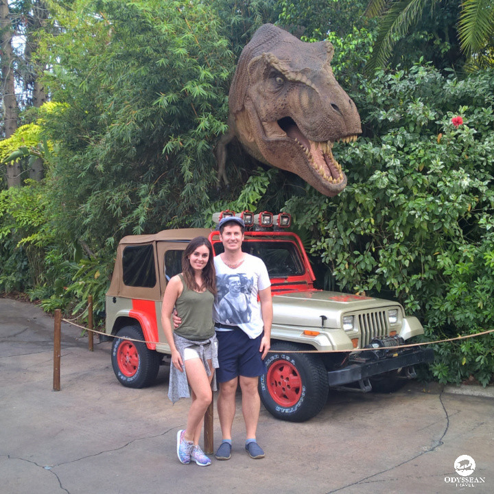 A young couple pose for a Jurassic Park themed photo at Island of Adventure, Universal Orlando