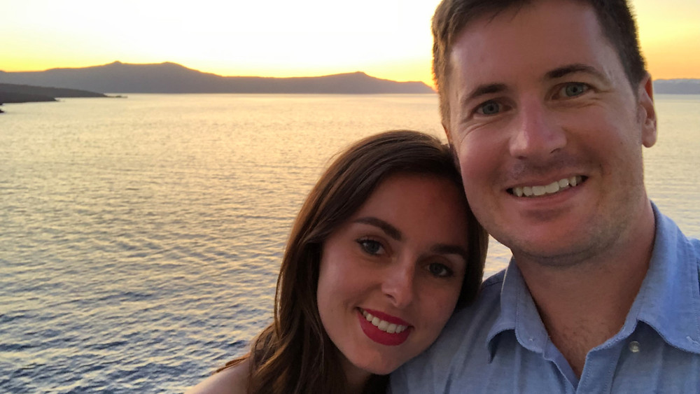 A couple enjoying a beautiful sunset in Santorini