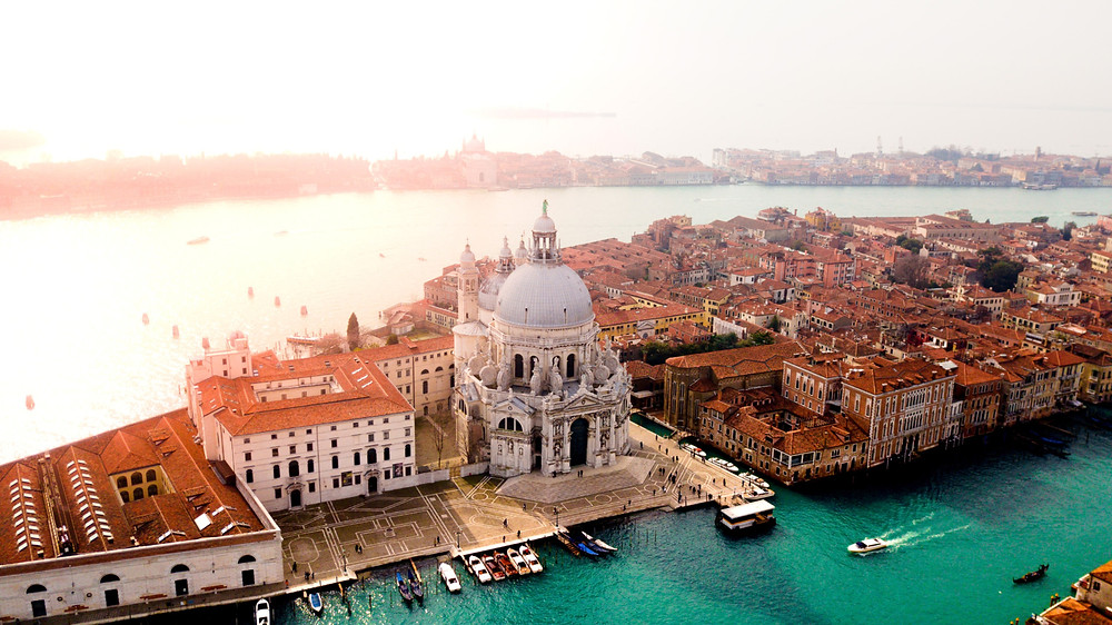 The sun shines over the beautiful architecture of Venice