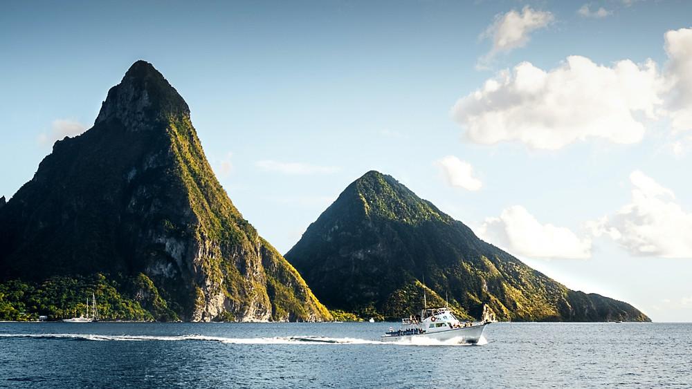Tour boat ferries passengers past Saint Lucia's famous Pitons