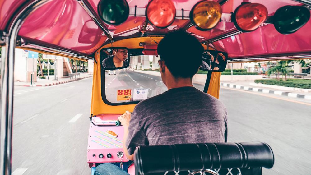 Cruising Bangkok from the back of a tuk tuk with no traffic