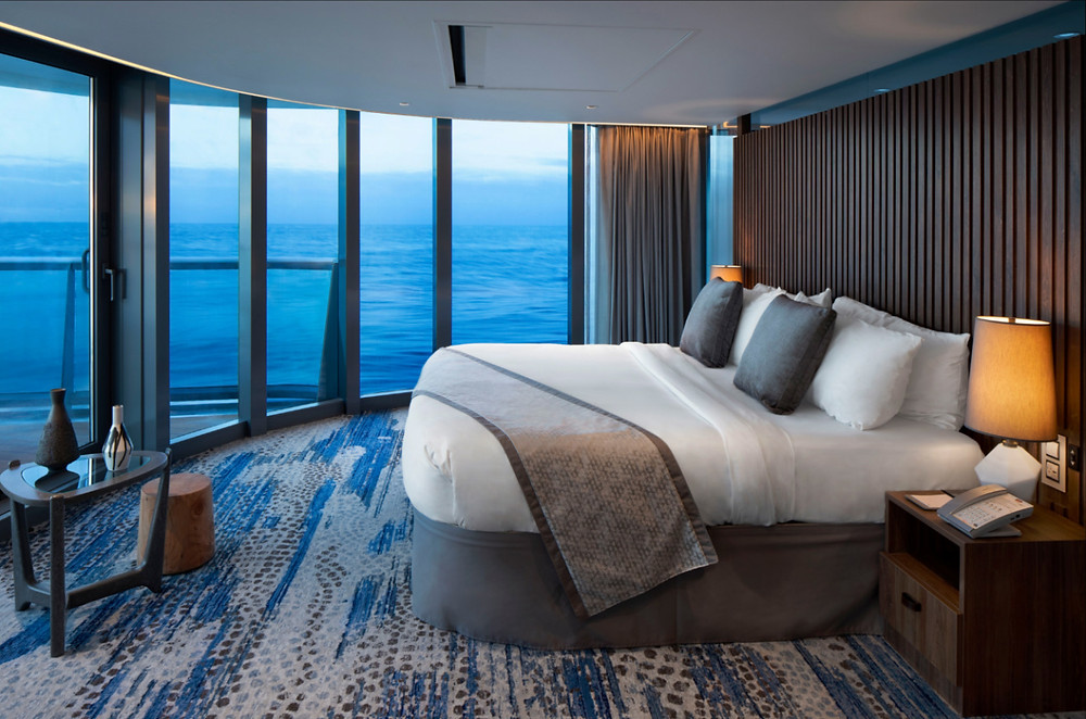 The most luxurious views of the Galapagos Islands feature a panoramic bedroom window in the large Penthouse Suite on board the Celebrity Flora