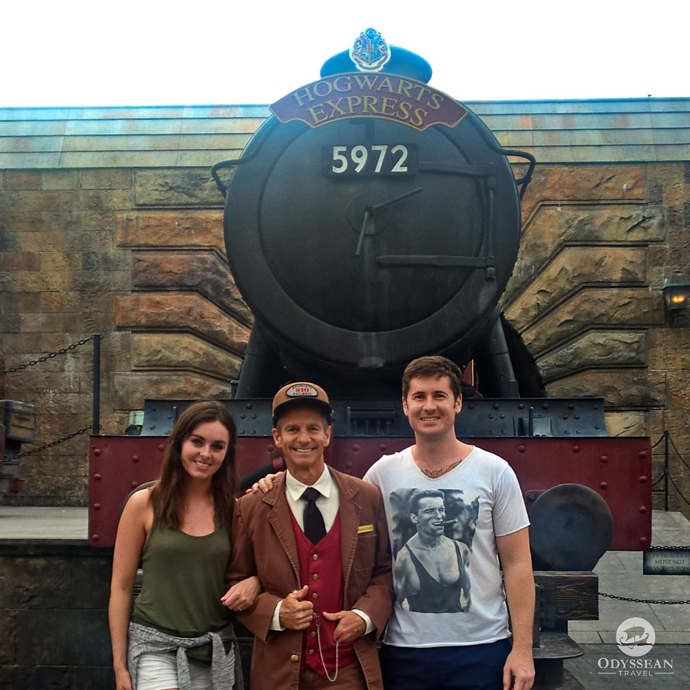 Posing with the conductor of the Hogwarts Express