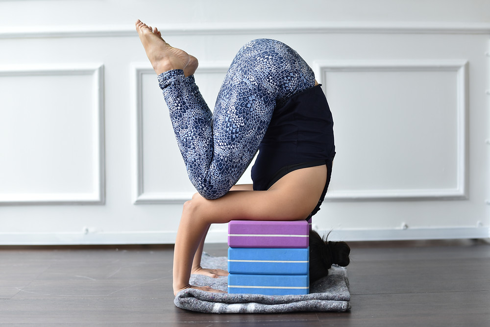 Ha My Yoga Malmö Sweden doing tripod headstand in Yoga, easy version with blocks and blankets