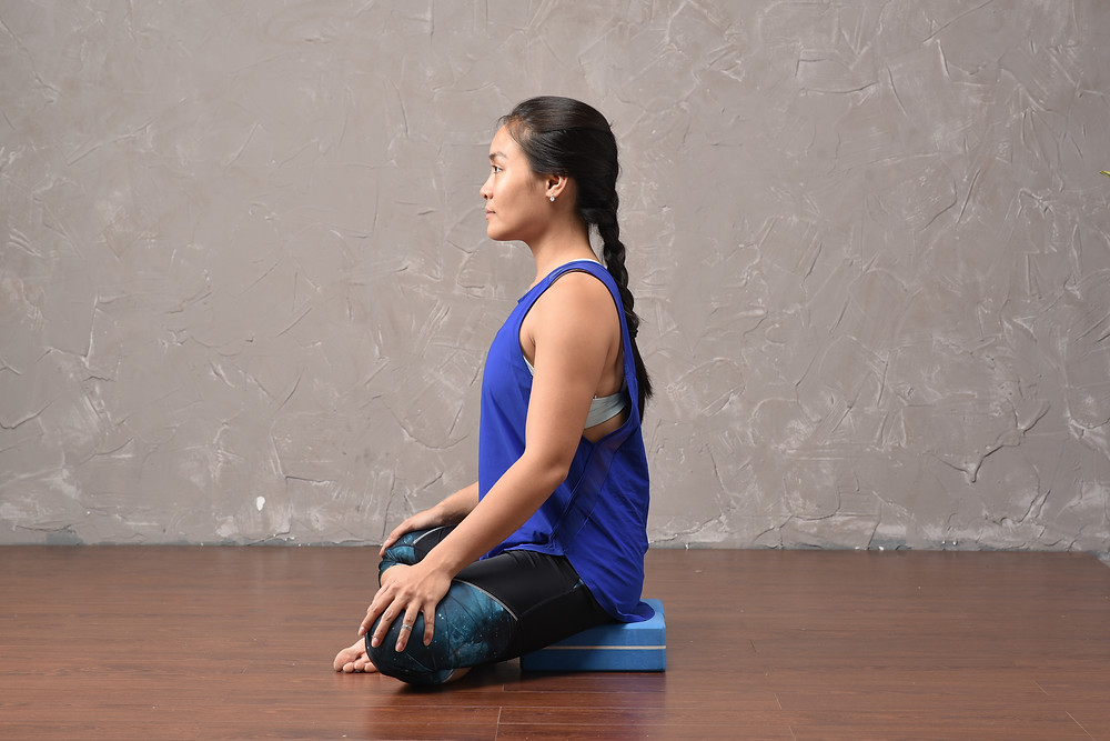 practice Yoga sukhasana with blocks to support the low back