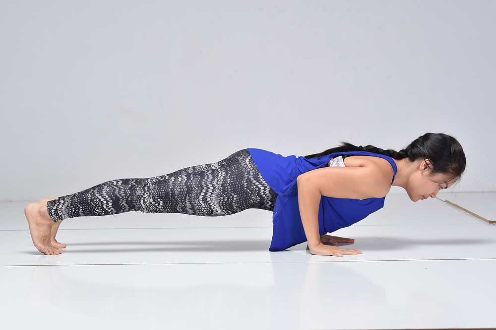 doing Chaturanga Dandasana, a Yoga pose, by Ha My Yoga, Malmö Sweden