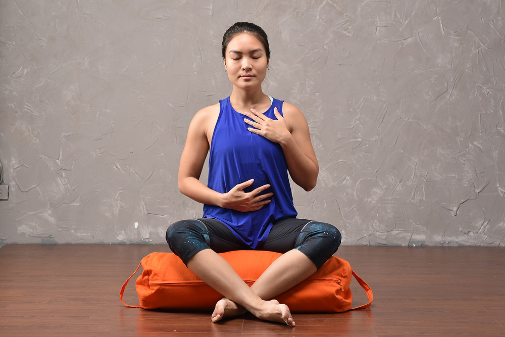 Practice Yoga in sitting pose with bolsters to support knees pain