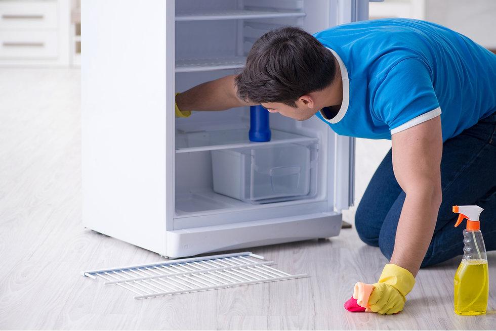 man-cleaning-fridge.jpg
