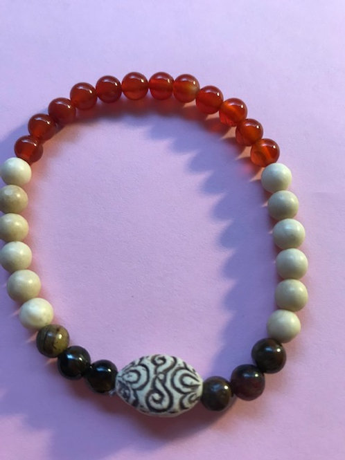 Beautiful healing bracelet made of wood, tigers eye, and carnelian